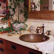 "White Italian tiles set off the marble counter in the bath. On the floor is a nostalgic ""daisy"" tile pattern in white and green hex tile with brick-red dots."