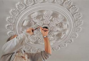 Artistic installations, such as this ceiling center by sculptor and master artisan David Flaherty, are done in plaster.