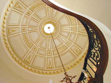 """Plaster? The dome ceiling is embellished with JP Weaver's pliable """"Petitsin"""" compo ornaments. The small medallion is Focal Point's egg-and-dart pattern #833 in polyurethane."""