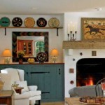 In the great room, the posts and beam are made from recycled antique wood. The fireplace surround is studded with Moravian tiles.