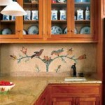 Kitchen cabinets are cherry, and practical countertops include both natural granite and Corian. The mosaic backsplash, designed and installed by the owners, has more than 26,000 natural stones.