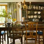 "Assembling mismatched Chippendale-style dining chairs was irresistible: ""Most antiquers have a weakness for chairs,"" Betty says. ""They're more affordable when not purchased as a set."" An early 18th-century French harvest table is brightened by an Asian vase."