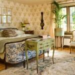 The master bedroom's documentary wallpaper is by Colefax & Fowler, reproduces from an 18th-century pattern. The Chinese Aubusson-style rug, delightfully threadbare, was purchased at auction.