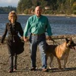 The Rutherfords walk along Puget Sound with their dog, Rudy.