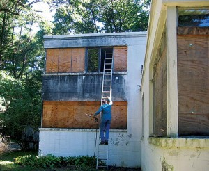 The author's husband used a gas-powered pressure washer and rainwater to clean the exterior of the house before utilities were restored.