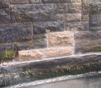 Repaired wall with new stones