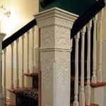 Newel posts on the main stairwell are original; the new crown molding was selected to complement them.