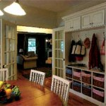 The breakfast nook boasts a wall of storage to organize the children's belongings.