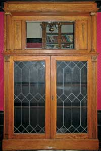 After an in-depth repair project, the leaded glass door fronting the author's built-in 1906 china cabinet looks good as new.