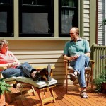 During the years they spent restoring the house, homeowner Kim McLanahan and contractor Charlie Allen—here enjoying their final project together, a new deck on the rear of the house—became friends and running partners.