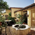 The courtyard, an extension of the kitchen addition, was planted with grapes, pomegranates, figs, and lavender to enhance the house's Mediterranean origins.