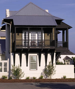 Massive structural brackets support the open porches on architect Eric Watson's beach house. He was inspired by Dutch Colonial, French Colonial, and Mission styles found throughout Florida.