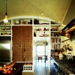 The kitchen is equipped with shelves for cookbooks and Merle's collection of African art.