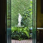 French doors frame the view of the courtyard fountain.