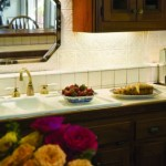 The kitchen cabinets are constructed of tidewater cypress. Pressed tin, left over from the front parlor ceiling, was used as a backsplash.