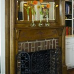 A salvaged oak Edwardian overmantel is the centerpiece of the den adjacent to the kitchen.