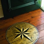 A hand-painted compass rose by decorative painter Kjel Flanagan adorns the longleaf pine flooring at the rear doorway.