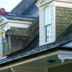 Elegant dormer windows project from the steep slope of the slate roof. The slate was salvaged from the Louisiana Governor's Mansion.