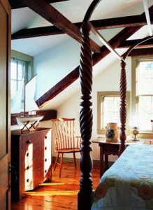 The master bedroom houses a wonderful canopy bed appropriate to the two periods of the new old house.
