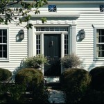 The door detailing evokes the Greek Revival style.