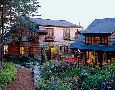 Bernhard & Priestley Architecture of Rockport, Maine, produces architecture that fits into its physical and social context. In its design of this rustic coastal Maine Shingle-style house, architectural history is a part of that context.