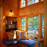 A built-in window seat and bookshelf offer a place to rest and read, as well as under-seat storage space.