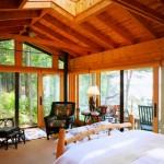 The master bedroom is reminiscent of a sleeping porch.