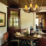 """The dining room is finished in 8""""-wide horizontal planks painted a celery color, which contrasts with the dark beadboard ceiling."""