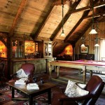 The horse barn was turned into a game room, finished with hand-hewn timber rafters and rough-sawn wall paneling.