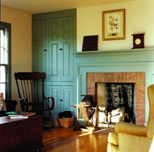 The sitting room's fireplace and cabinetry were inspired by early Greek Revival homes in the area. The house is heated with radiant flooring.
