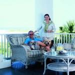 Jeffrey L. Davis and Christine G.H. Franck enjoy a cool drink on the open porch.