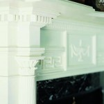 The bedroom fireplace mantel picks up the Corinthian detailing, along with the Greek key pattern.