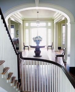 As one ascends the 10-foot-wide, three-story staircase from the entry below, the view through the central corridor leads the eye out to the water and the broad horizon. The transverse arch has a historic precedent in this region of North Carolina.