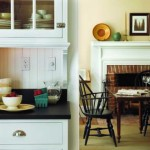 Here, as in all the downstairs rooms, color is found on the walls, while the trim is kept creamy white.