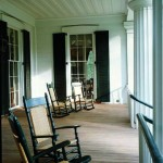 The veranda's coffered ceiling is a regional flourish, and the rocking chairs are a pleasurable necessity.