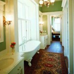 The master bath's long, narrow dimensions call to mind a hallway, but even in this tight space, Historical Concepts allowed for modern necessities without compromising the illusion of an old home.