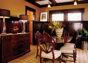 The dining room wainscotting and window casings are finished in a dark varnish typical of varnishes used 100 years ago.