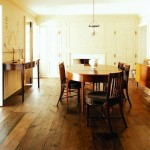 The dining room is located in an original space, although the paneled walls and fireplace mantel are all new millwork.