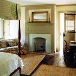 The guest bedroom fireplace received a simple overmantel. Dutch doors lead to a screened porch.