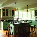 The kitchen offers ample storage and views out to the hillside.