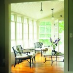A beadboard ceiling was added to the glassed-in porch.