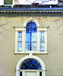 Epoxy glue helped restore this Palladian window. Deteriorated wood was removed, and new pieces were spliced in to support the upper window panes.<br>