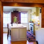 """The kitchen is connected to the great room but separated by a hallway—""""so you don't feel like you are living in pots and pans,"""" says Zimmerman."""