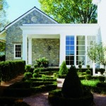 Off the side entry and porch, a boxwood garden was added for visual interest.