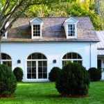 The back of the garage was given over to an orangery by replacing the ficticious carriage house doors with arched windows.