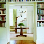 Custom built-in bookcases frame the entry to the den from the stair hall.