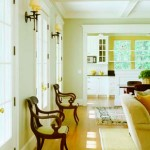 The great room opens directly to the kitchen and is separated only by a paneled knee wall.