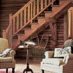 The architects refurbished the main log cabin into a cozy country retreat. The walls are interior logs stained a warm golden amber.