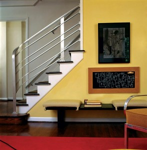 To replace the original balusters and rail, which had been torn out, the Donnellys adapted the salvaged aft staircase from an ocean liner.