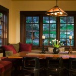 Built-in benches that offer cozy seating in the dining nook were added by a previous owner; the wood windows surrounding them were completely refurbished by Nathan, and retrofitted with period-appropriate hardware.